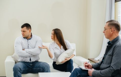 a-young-married-couple-of-men-and-women-talk-to-a-psychologist-at-a-therapy-session-psychology_180601-9019