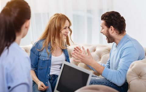 family-fight-furious-handsome-bearded-man-looking-at-his-wife-and-shouting-at-her-while-sitting-in-the-psychologists-office_259150-13713