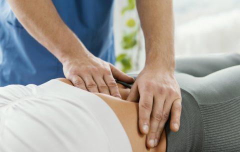 male-osteopathic-therapist-checking-female-patient-s-abdomen_23-2148846618
