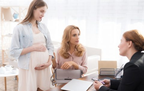 mother-with-pregnant-daughter-in-doctor-office_85574-2253