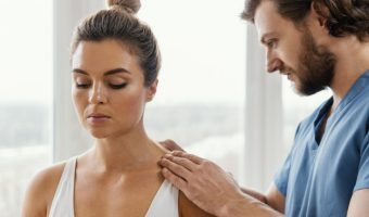 side-view-of-male-osteopathic-therapist-checking-female-patient-s-back_23-2148846602