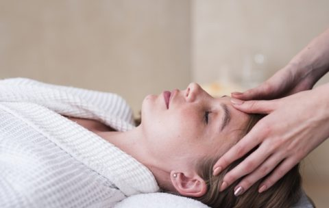 woman-getting-head-massage-at-spa_23-2148345773